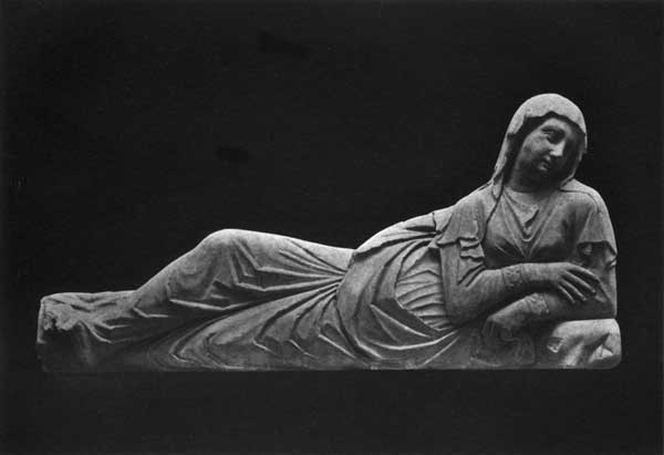 RECLINING FEMALE FIGURE FROM A TOMB